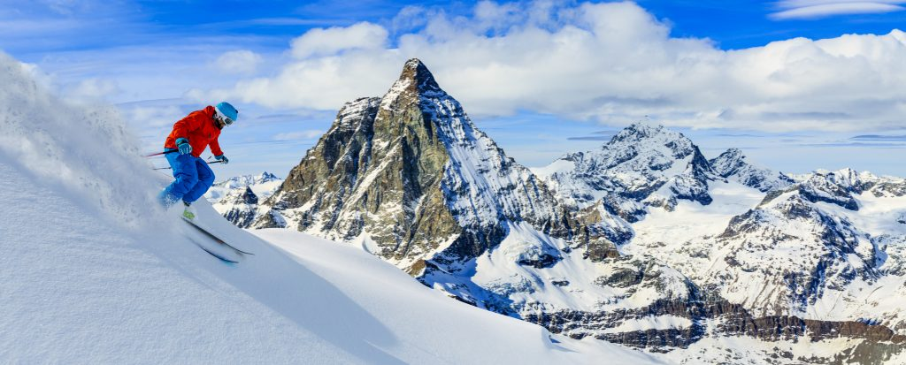 Skiing with amazing view of swiss famous mountains in beautiful winter snow. Matterhorn, Zermatt, Swiss Alps.